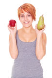 Woman showing apple and pear Royalty Free Stock Image