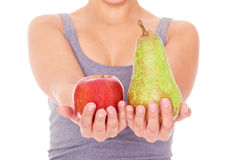 Woman showing apple and pear Royalty Free Stock Photography
