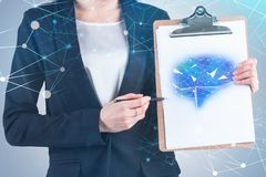 Woman showing artificial intelligence sketch. Unrecognizable businesswoman showing brain sketch on her clipboard with double exposure of polygonal network stock illustration