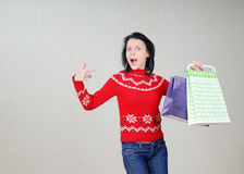 Woman showing the bags with gifts Royalty Free Stock Photography