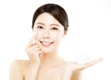 Woman showing  beauty product on hand Royalty Free Stock Images