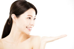 Woman showing  beauty product on hand Royalty Free Stock Photography