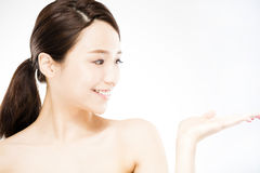 Woman showing  beauty product on hand Stock Photo