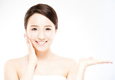 Woman showing  beauty product on hand Royalty Free Stock Photos