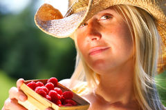 Woman showing berries Stock Images