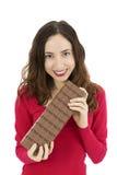 Woman showing a big chocolate bar Stock Photography