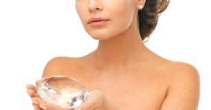 Woman showing big diamond Royalty Free Stock Photography