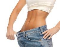 Woman showing big pants Stock Photo
