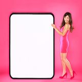 Woman showing big sign. Beautiful happy sexy young woman in pink dress holding big blank empty sign board with copy space for your text or design. Mixed race Royalty Free Stock Photos
