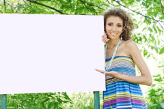 Woman showing billboard Royalty Free Stock Photo