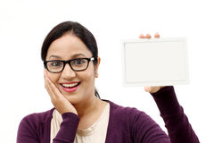 Woman showing blank business card. Against white Stock Photography