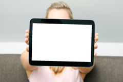 Woman showing blank digital tablet Royalty Free Stock Photo