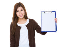 Woman showing the blank page of clipboard for advertisement. Isolated on white background Stock Photos