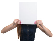 Woman showing a blank paper sheet Royalty Free Stock Photos