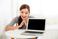 Woman showing blank screen of notebook computer Stock Image