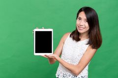 Woman showing blank screen of tablet computer. Asian young woman Stock Photos