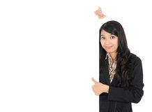 Woman showing blank signboard. Businesswoman showing blank signboard with thumb up, isolated on white background Royalty Free Stock Photos