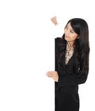 Woman showing blank signboard. Young businesswoman showing blank signboard, isolated on white background Royalty Free Stock Images
