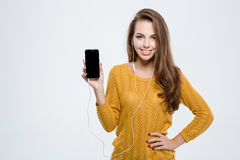 Woman showing blank smartphone screen Royalty Free Stock Image