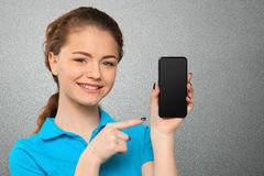 Woman showing blank smartphone screen Royalty Free Stock Photo