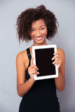 Woman showing blank tablet computer screen Stock Photos
