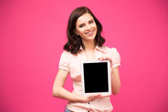 Woman showing blank tablet computer screen Stock Images