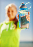 Woman showing a bottle of water Royalty Free Stock Photos