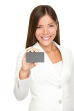 Woman showing business card stock photo