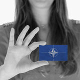 Woman showing a business card Stock Images
