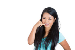 Woman showing call me phone hand sign smiling happy Stock Photo