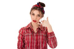 Woman showing call me sign gesture with hand royalty free stock photos