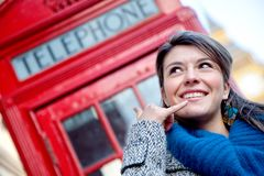 Woman showing calling gesture Royalty Free Stock Photo