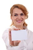 Woman showing a card Stock Images