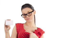Woman showing card making face Royalty Free Stock Image