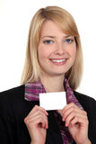 Woman showing card Stock Photo
