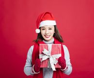 Woman showing the christmas gift box Stock Image