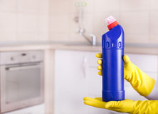 Woman showing cleaning product Stock Photography