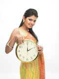 Woman showing the clock stock images