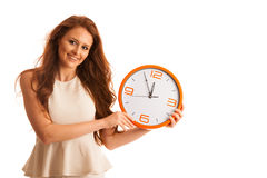 Woman showing a clock as a sign of  time management Royalty Free Stock Photo