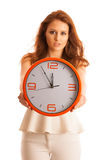 Woman showing a clock as a sign of  time management Royalty Free Stock Photography