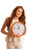 Woman showing a clock as a sign of  time management Royalty Free Stock Images