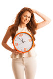 Woman showing a clock as a sign of  time management Stock Images