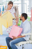 Woman showing clothes to her boyfriend Royalty Free Stock Image