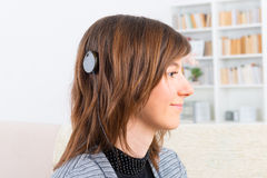 Woman showing cochlear implant Royalty Free Stock Image