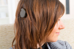 Woman showing cochlear implant Royalty Free Stock Photos
