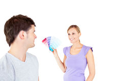 Woman showing color samples to his boyfriend Stock Image