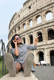 Woman showing at Colosseum Stock Photos