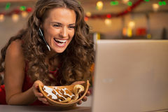 Woman showing cookies and having video chat Royalty Free Stock Photography