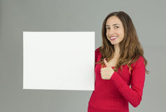 Woman showing copy space and giving thumbs up Stock Photography