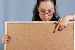 Woman is showing on cork board Stock Photography